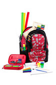 Black and red packback with school supplies — Stock Photo