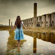 Woman walking among ruins — Stock Photo