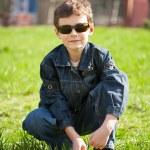 Cool boy on a grass field — Stock Photo #2844932