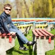 Cool boy sitting in a park — Stock Photo
