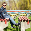 Cool boy sitting in a park — Stock Photo #2844964