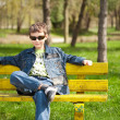 Cool kid sitting on bench - Foto de Stock  