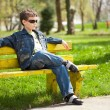 Cool kid sitting on bench — Stock Photo #2844989