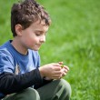 Gorgeous boy in a grass field — Stockfoto