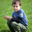 Gorgeous boy in a grass field — Stock Photo #2845005