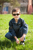 Cool boy on a grass field — Stock Photo