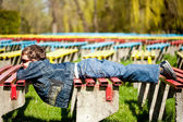 Cute kid lying on benches — Stock Photo