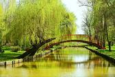 Bridge over water in park — Stock Photo