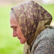 Old woman with kerchief — Stock Photo