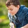 Cute kid drinking water in a park — Stock Photo #2892917