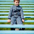 Cute schoolboy in a park — Stock Photo #2892947