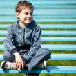 Cute schoolboy in a park — Stock Photo #2892950