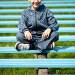 Cute schoolboy in a park — Stock Photo #2892951