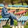 Cute schoolboy in a park — Stock Photo #2892961