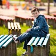 Cute schoolboy in a park — Stock Photo #2892968