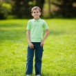 9 years old kid in a park - Stock Photo