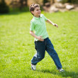 Royalty-Free Stock Photo: Boy running on a meadow