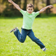 Kid jumping for joy — Stock Photo