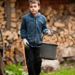 Child with a bucket - Stock Photo