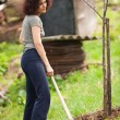 Young redhead lady gardening — Stock Photo