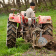 Stock Photo: Old farmer plowing