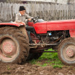 Old farmer plowing — Stock Photo