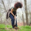 Stock Photo: Young redhead lady gardening