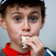 Funny little boy eating bread — Stock Photo