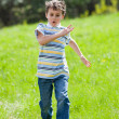 Caucasian child running on grass — Stock Photo
