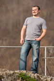 Young man full body portrait outdoors — Stock Photo