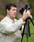 Caucasian man filming — Stock Photo