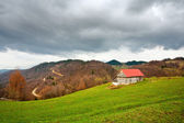 Single house on a pasture — Stock Photo