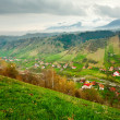 Stock Photo: Rural landscape with mountains and clouds