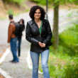 Attractive woman walking outdoors — Stock Photo