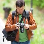 Photographer outdoors — Stock Photo