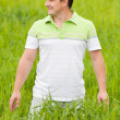 Young man in a wheat field — Stock Photo