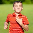 Cute kid running on grass — Stock Photo #3126651