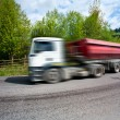 Stock Photo: Motion blur of speeding truck