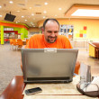 Stock Photo: Mwith laptop in restaurant