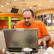 Man with laptop in restaurant — Stock Photo #3142635