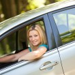 Beautiful girl enjoying her new car — Stock Photo #3222172