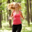 Royalty-Free Stock Photo: Blonde lady running