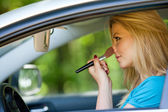 Woman makeup in the car — Stock Photo