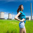 Sexy lady in an industrial background — Stock Photo