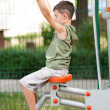 Boy doing fitness outdoor and having fun — Stockfoto
