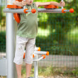 Boy doing fitness outdoor and having fun — Stock Photo