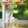 Boy doing fitness outdoor and having fun — Stock Photo #3390240