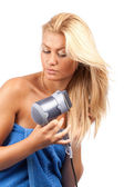 Blonde beauty with hair drier — Stock Photo