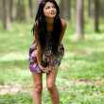 Attractive latin girl posing outdoor — Stock Photo