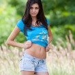 Attractive hispanic girl in the forest — Stockfoto